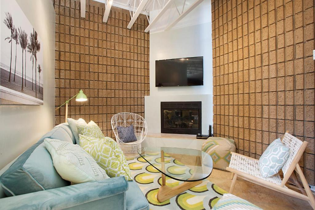A seating area at Three-Bedroom, Ocean Townhouse