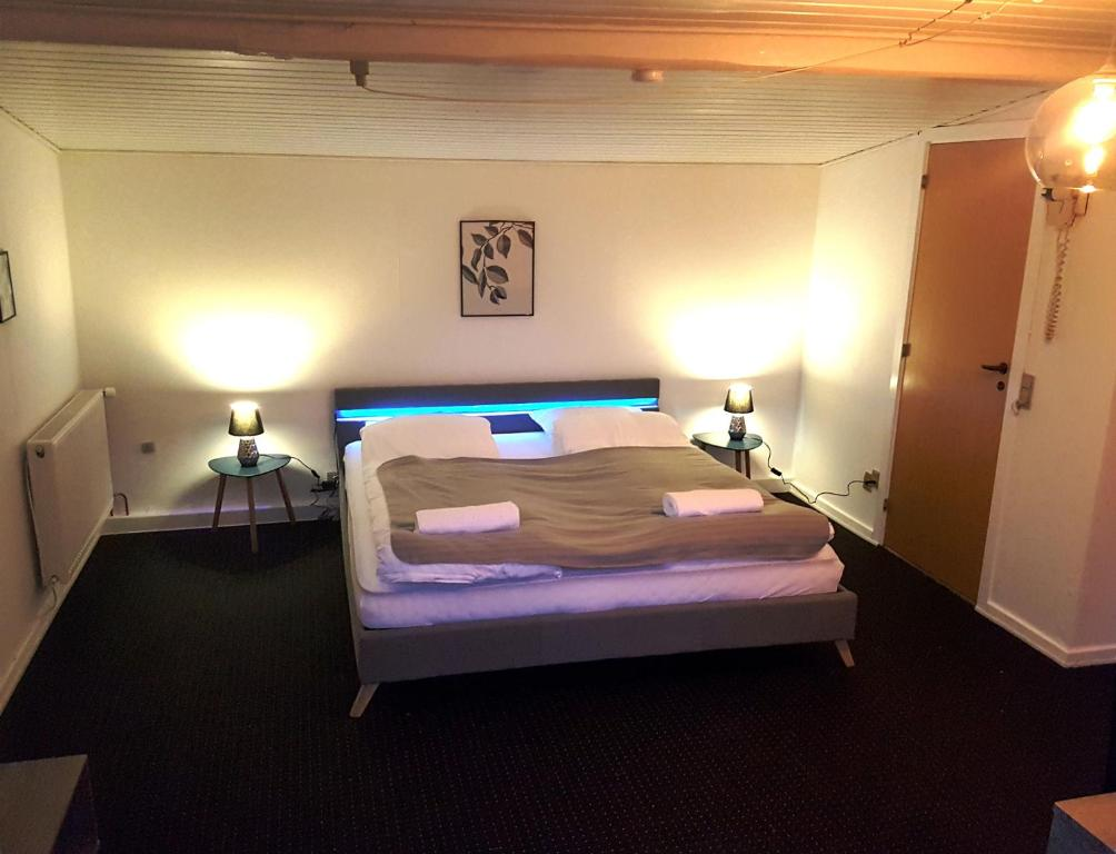 En eller flere senge i et værelse på GæstGiverGården
