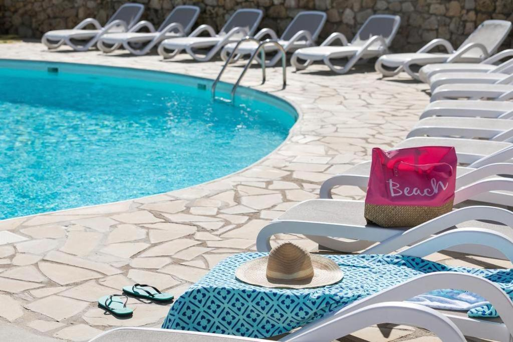 The swimming pool at or near Bungalow Vacances - Riviera Vacances