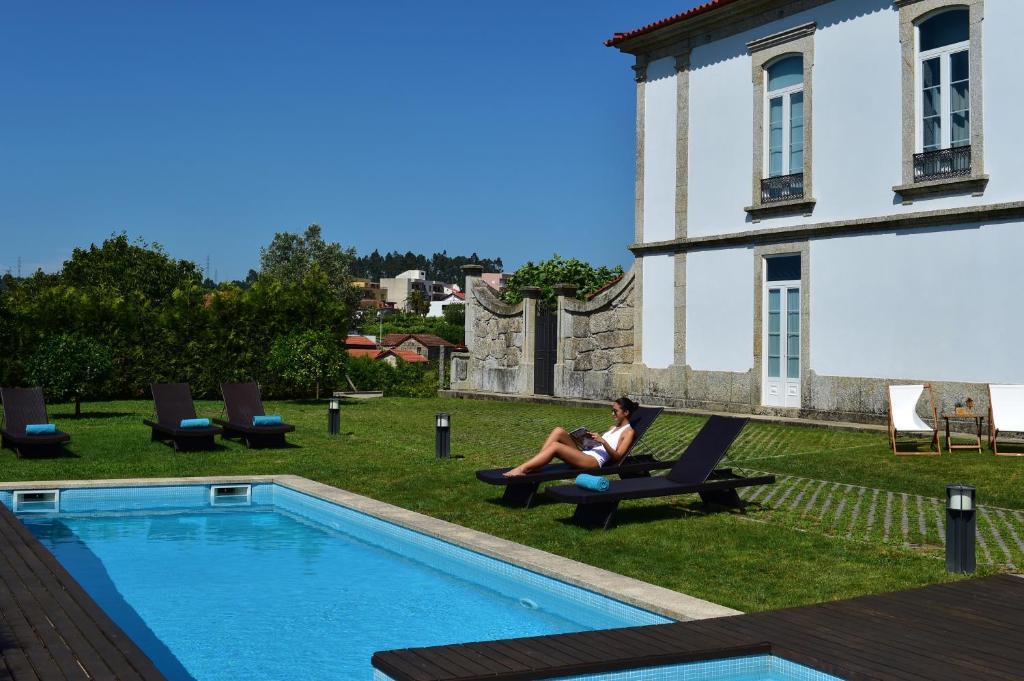 The swimming pool at or near Solar Egas Moniz-Charming House & Local Experiences