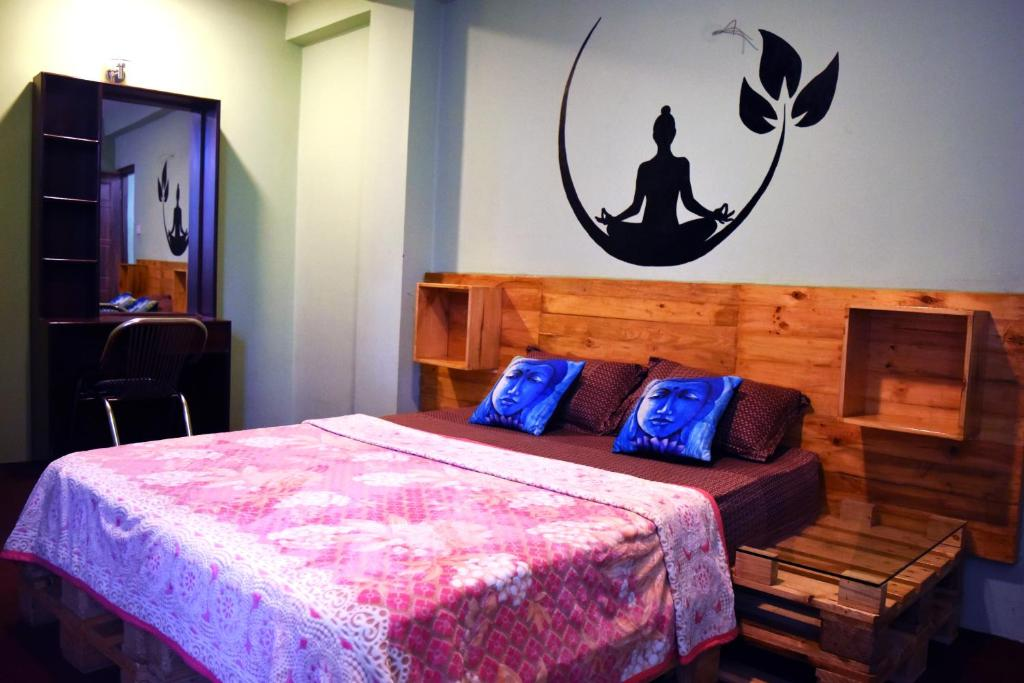 A bed or beds in a room at Yog Hostel