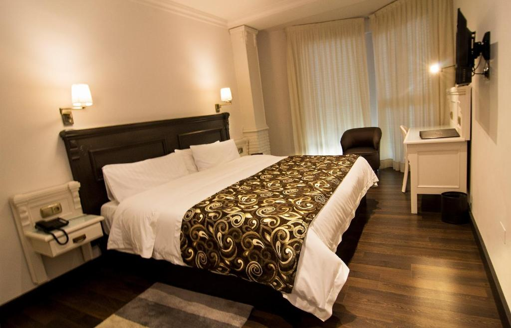 A bed or beds in a room at Avent Verahotel