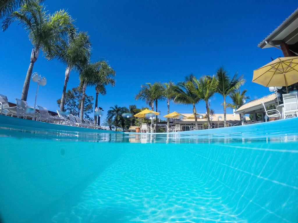 The swimming pool at or near Pousada Ponta do Lobo