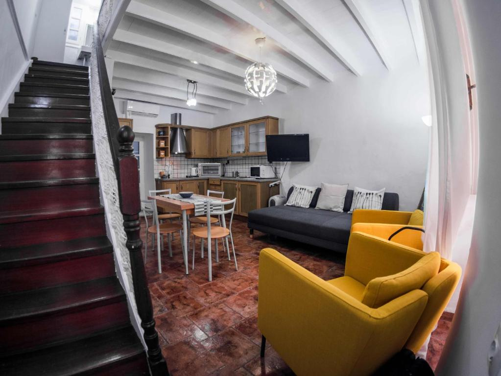 """A seating area at LOC Hospitality """"Venetian Well Square"""" family maisonette"""