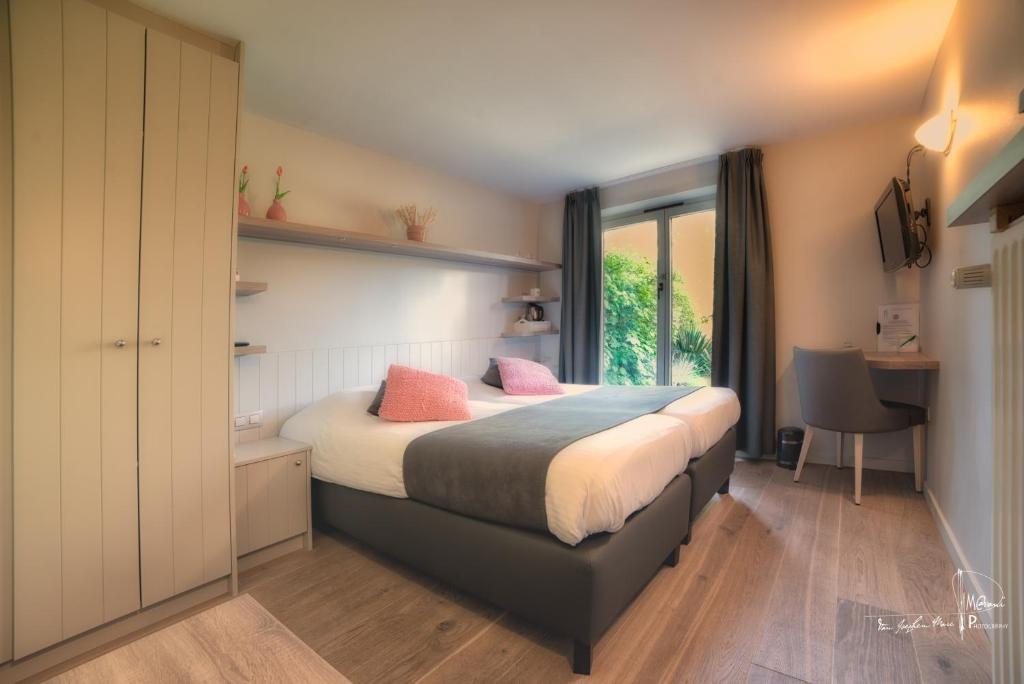 Un ou plusieurs lits dans un hébergement de l'établissement Hotel Bilderdijk