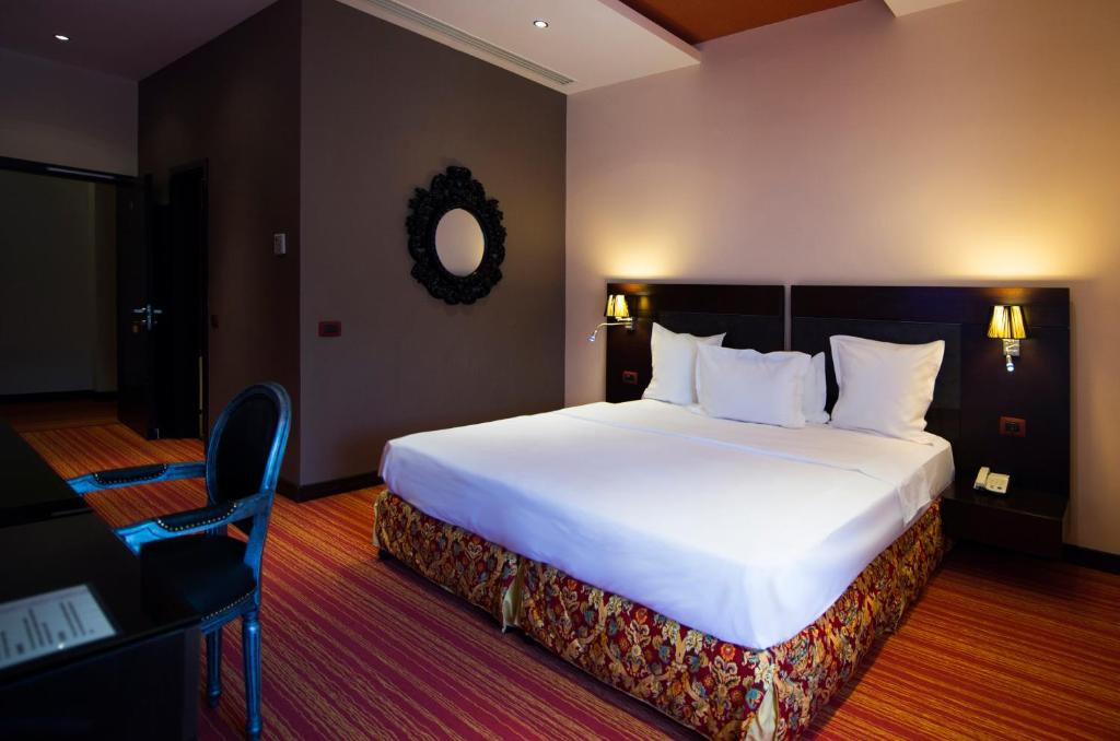 A bed or beds in a room at Nane Hotel