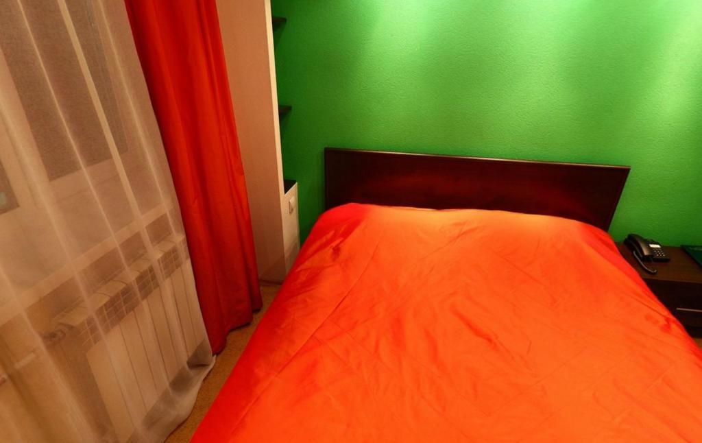 Кровать или кровати в номере Отель Александр Хаус