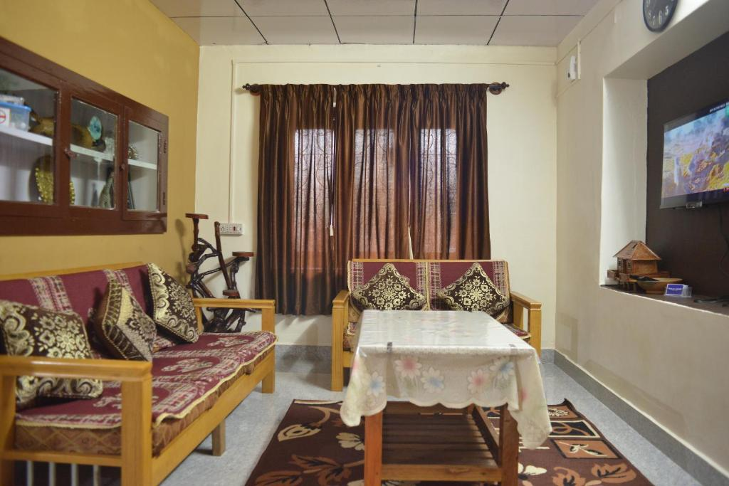 A seating area at Agasthya Homestay - With Kitchenette