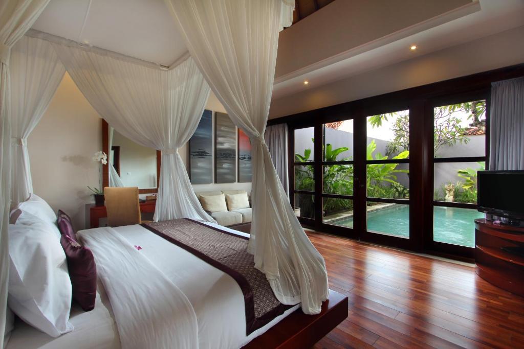 Un ou plusieurs lits dans un hébergement de l'établissement Aria Exclusive Villas & Spa