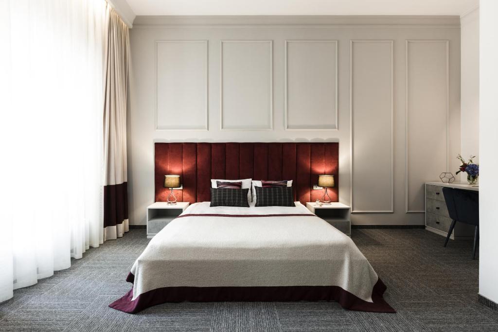 Deribas Hotel tesisinde bir odada yatak veya yataklar