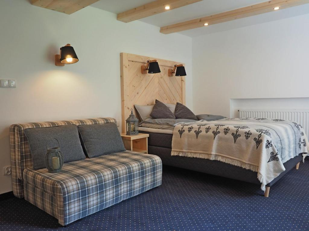 A bed or beds in a room at Willa Mountain Centrum