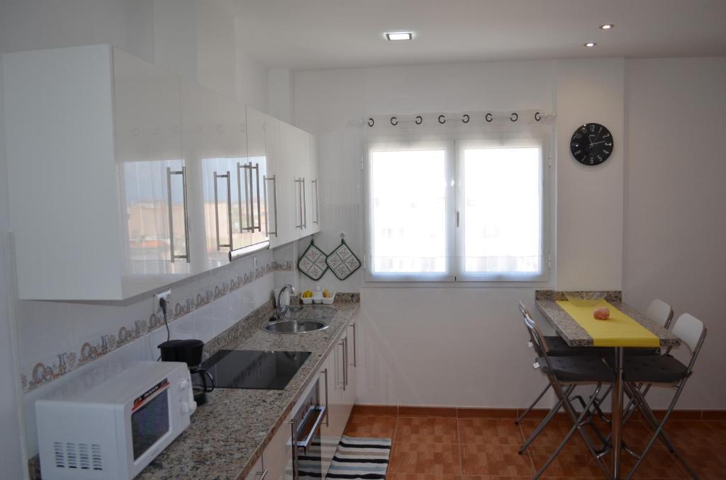 Una cocina o zona de cocina en Apartamentos Sarmiento