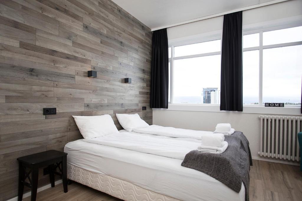 Un pat sau paturi într-o cameră la Stay Apartments Bolholt