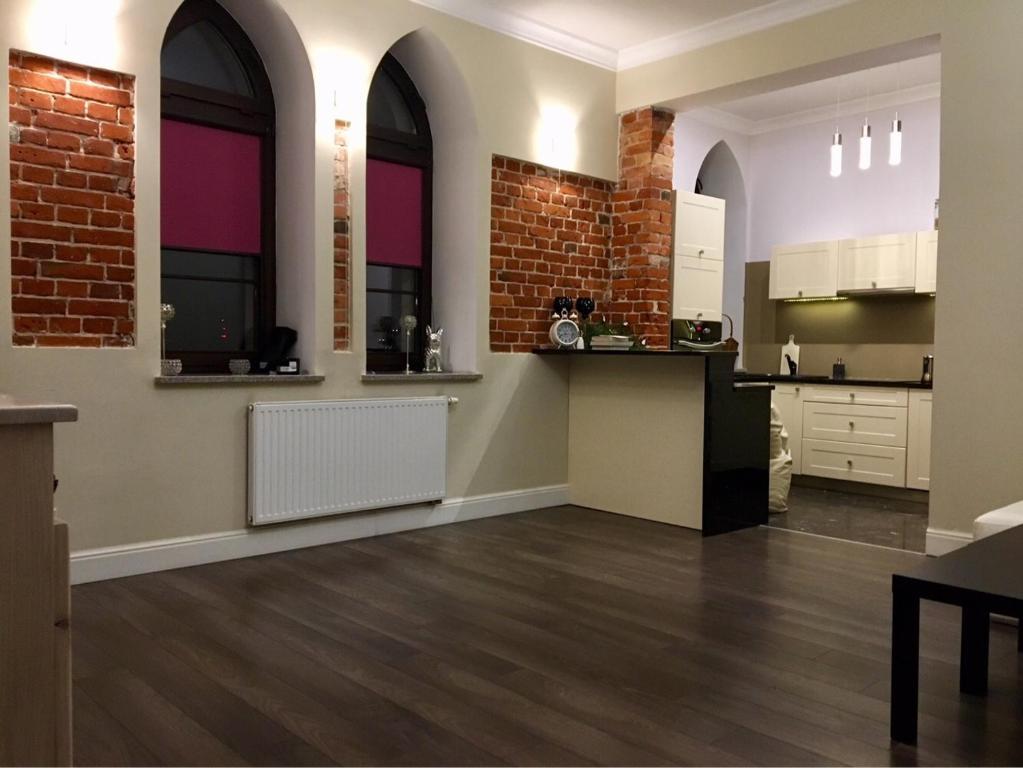 Кухня или мини-кухня в Apartament Olsztyn: Kamienica nad jeziorem jak w domu