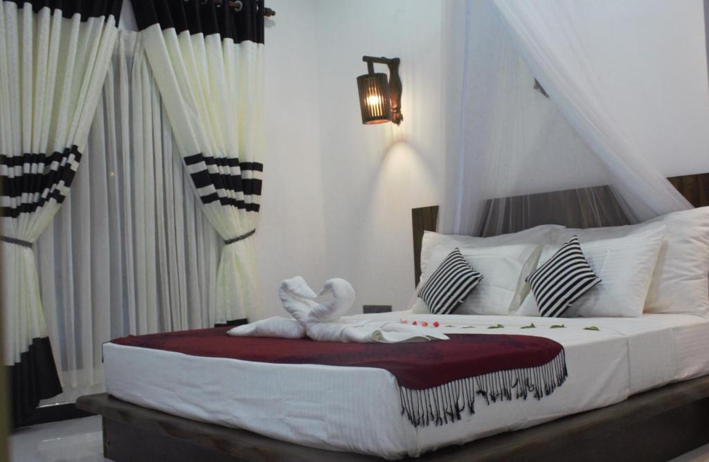 Ein Bett oder Betten in einem Zimmer der Unterkunft Venus Paradise Sigiriya