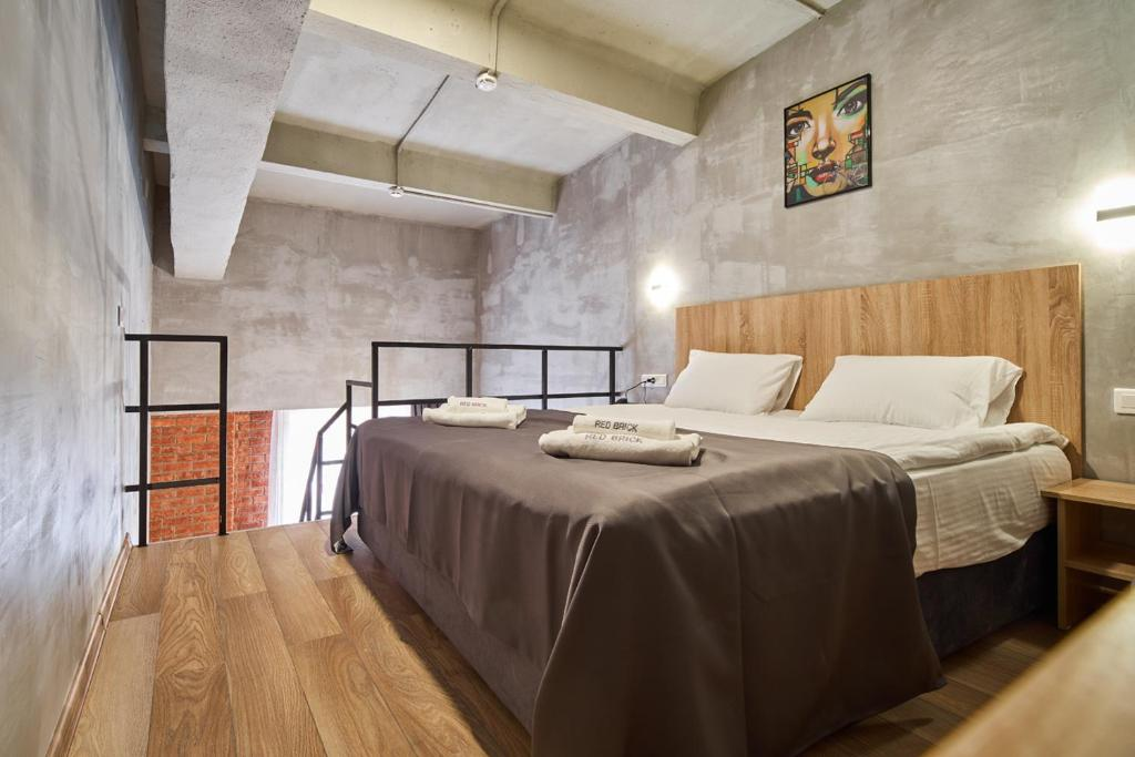 A bed or beds in a room at Red Brick Hotel Presnya