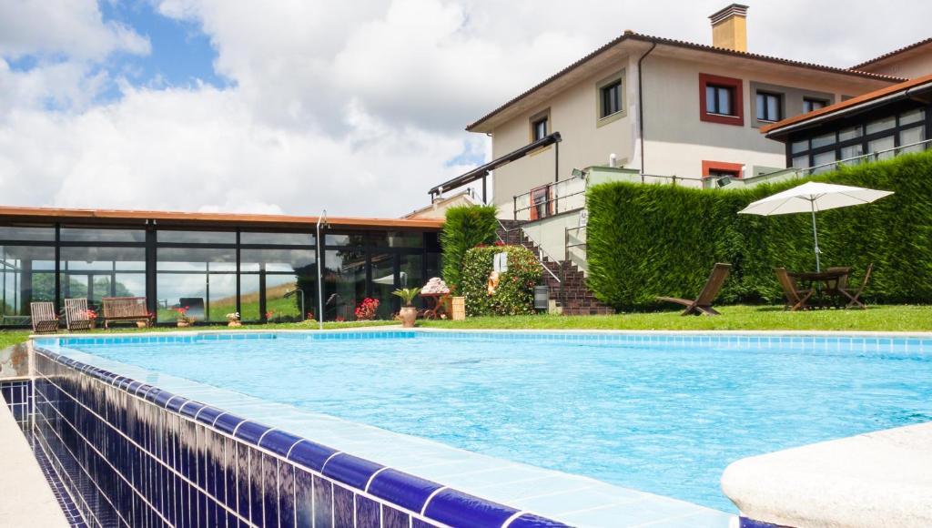 The swimming pool at or near Hosteria de Torazo Nature Hotel & Spa