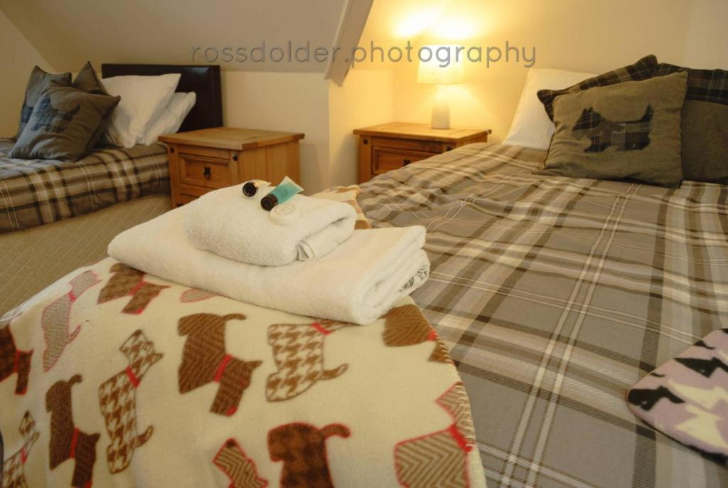 A bed or beds in a room at The Hopetoun Arms Hotel