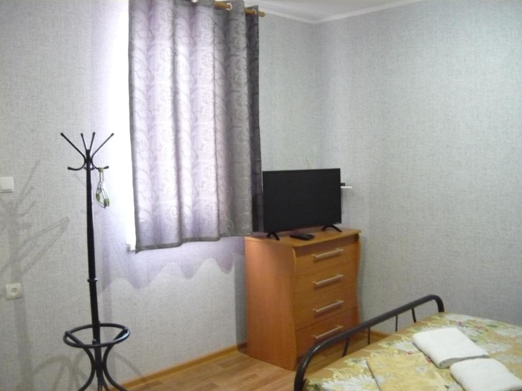 A television and/or entertainment center at Guest House Azov