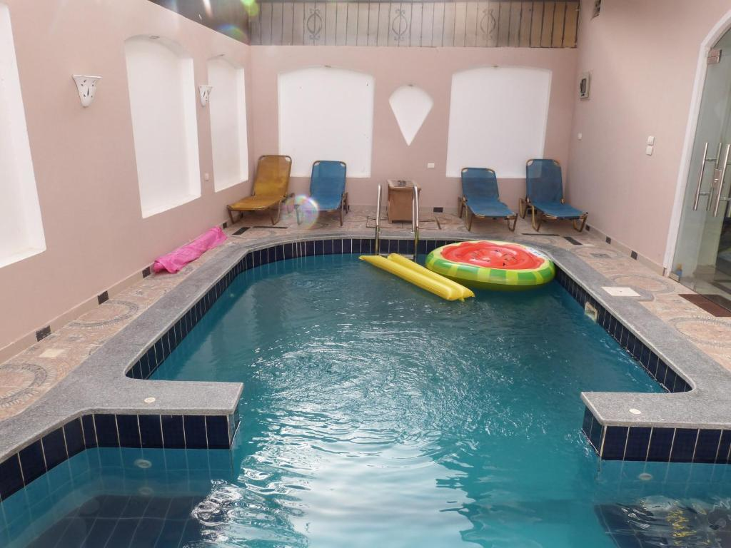 The swimming pool at or near Gold Ibis Hotel