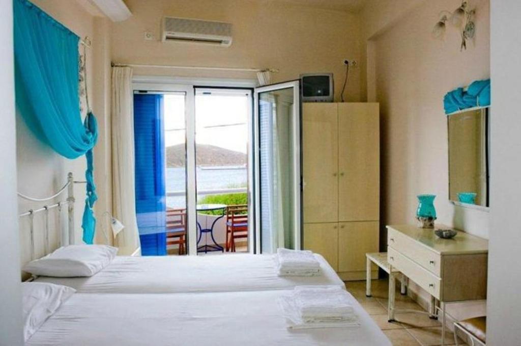 Ένα ή περισσότερα κρεβάτια σε δωμάτιο στο Hotel Cyclades