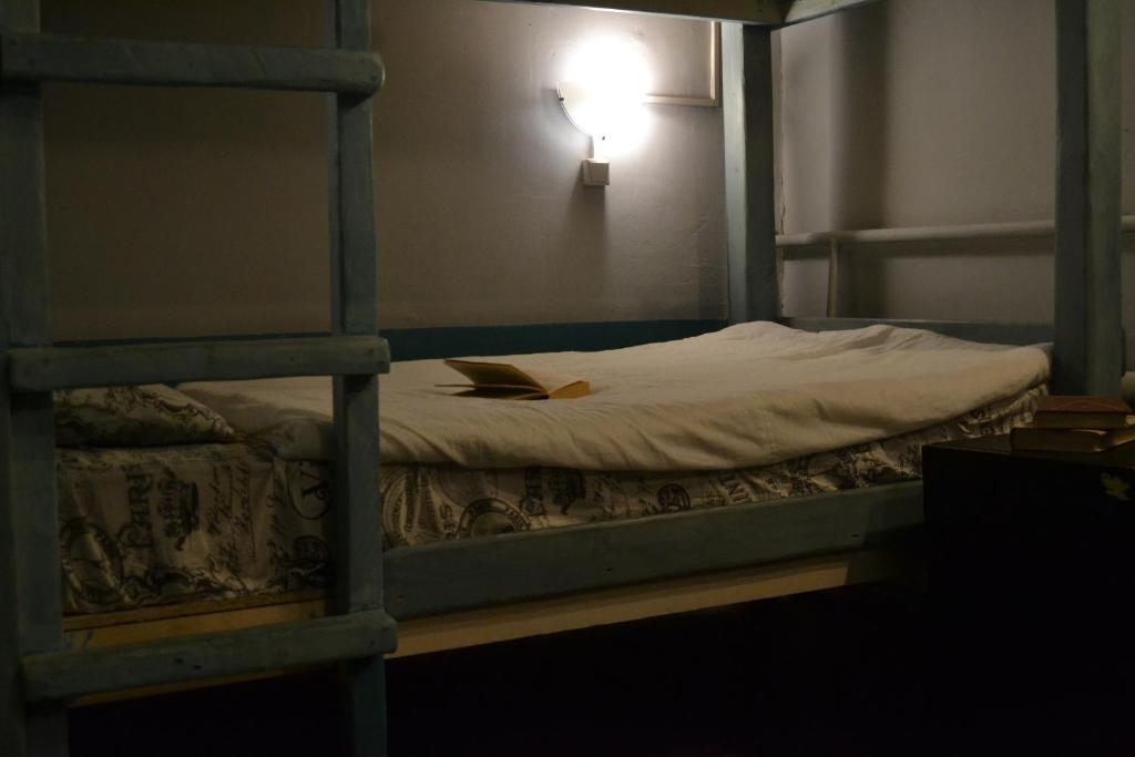 A bed or beds in a room at «Horizontal»