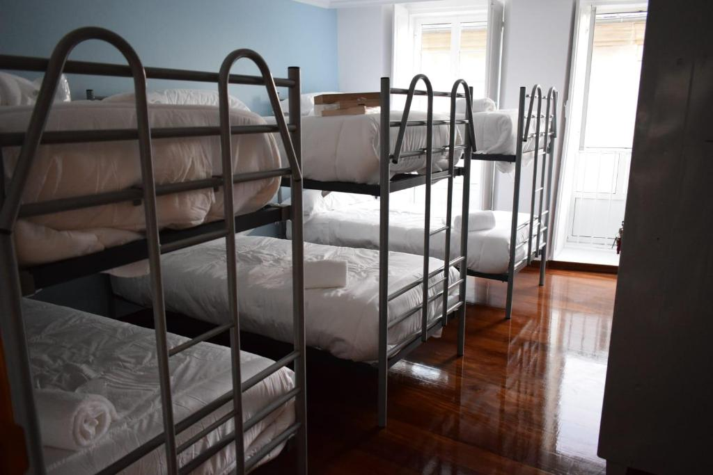 A bunk bed or bunk beds in a room at Hostel O Miño