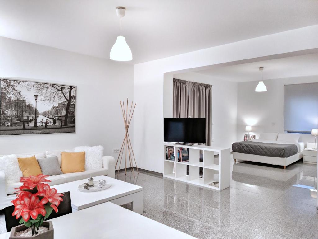 A seating area at Brand new budget apartment next to Iaso and Oaka
