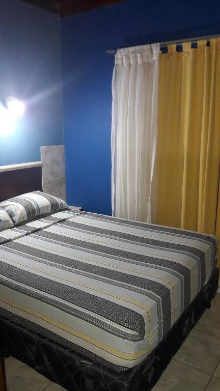 Una cama o camas en una habitación de Flia Ocampo