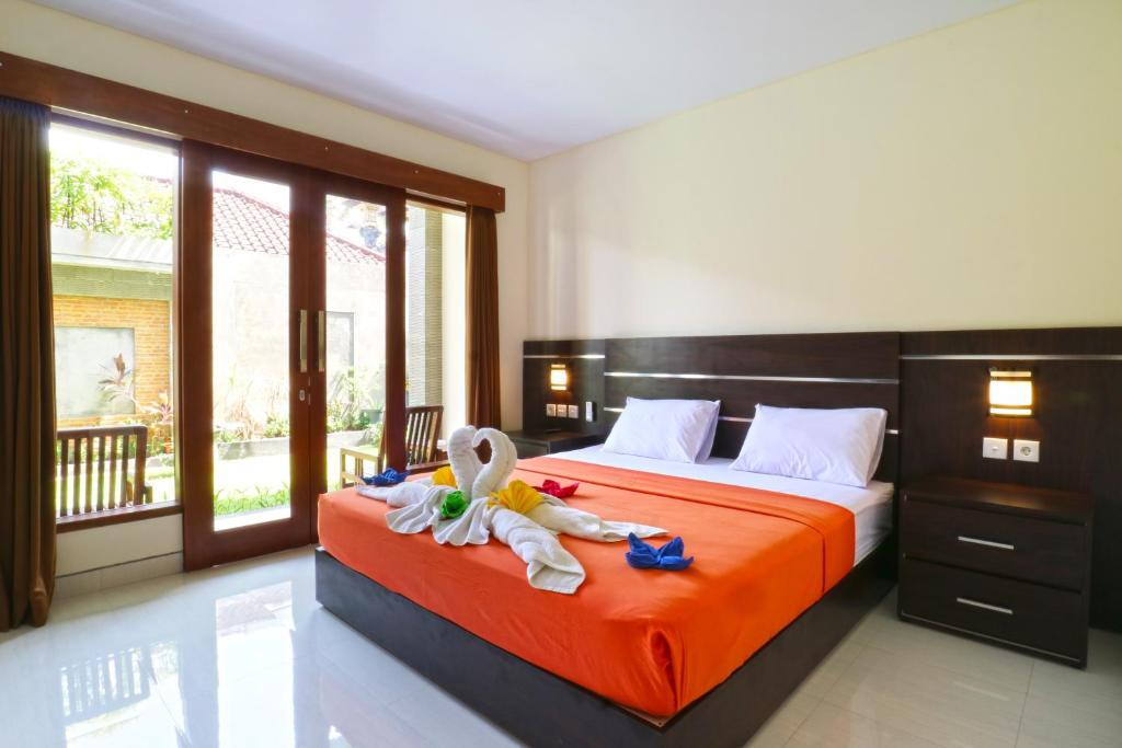 A bed or beds in a room at Gempita House Bali
