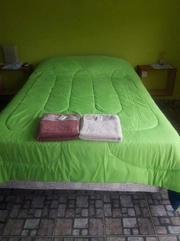 Una cama o camas en una habitación de Hospedaje Vista al Mar