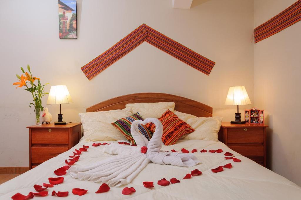 Cama o camas de una habitación en Kuna del Inka Hospedaje
