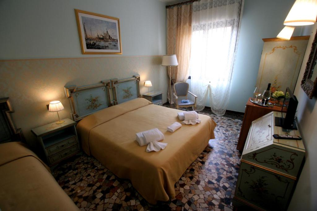 A bed or beds in a room at Venice Lion Residence - Vespucci