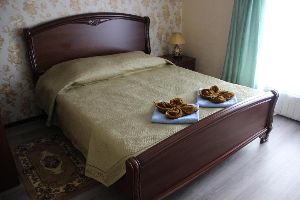 Кровать или кровати в номере Guest House Volna
