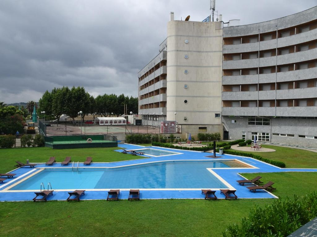 The swimming pool at or near Grande Hotel Dom Dinis