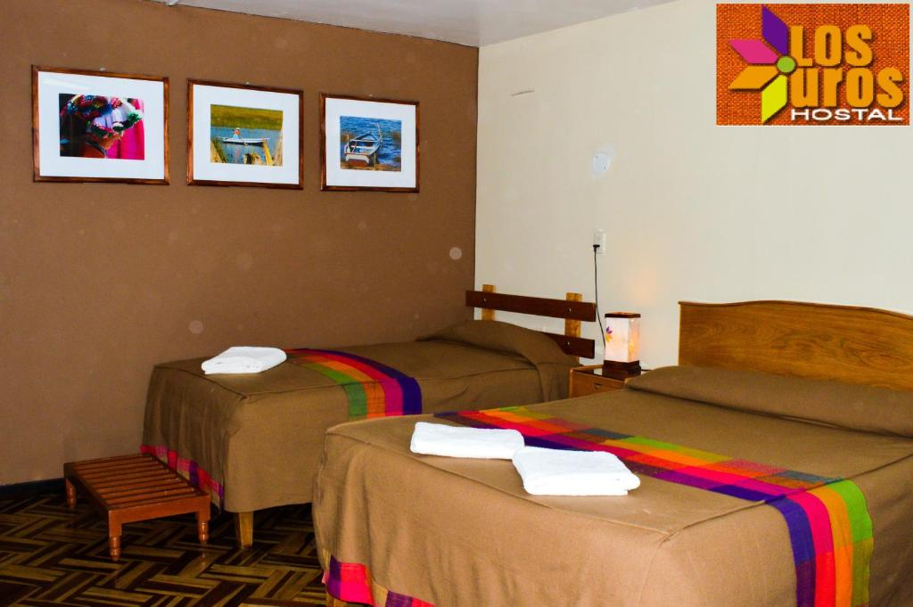 A bed or beds in a room at Hostal los Uros