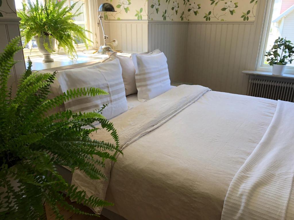 Säng eller sängar i ett rum på Villamilsten B&B