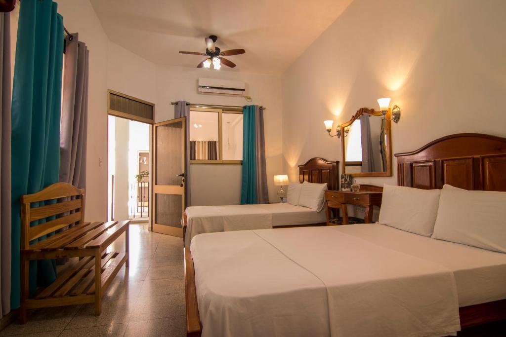 Cama o camas de una habitación en BR& Hostal Sunrise