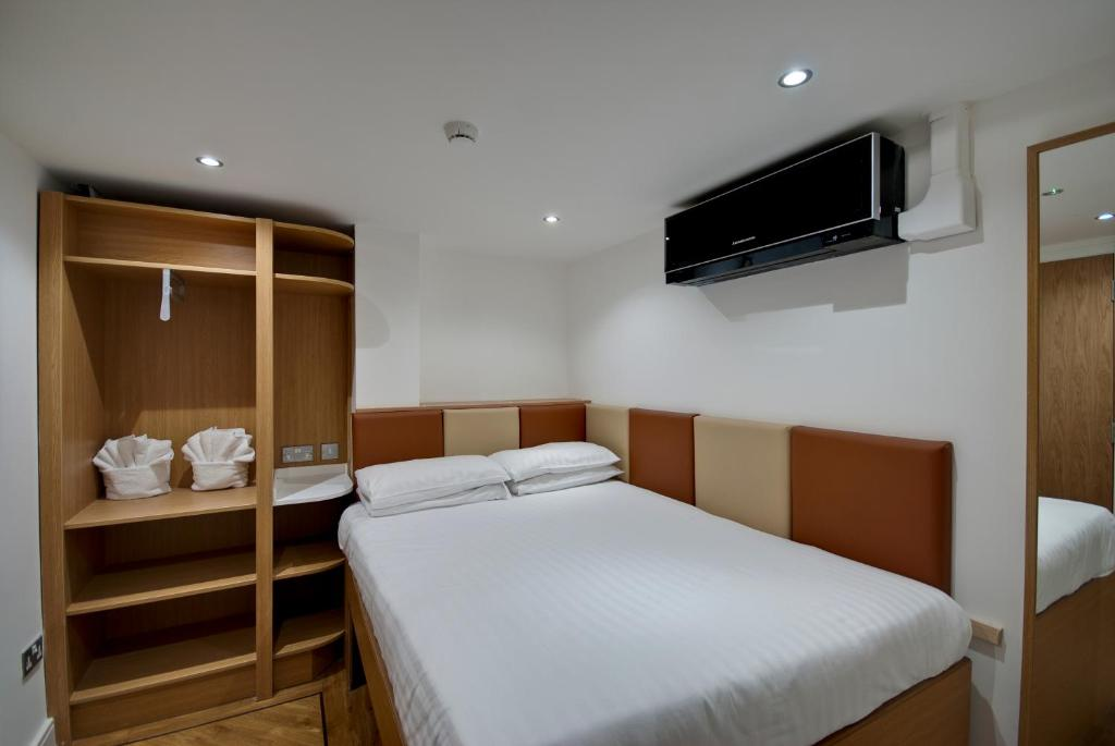 A bed or beds in a room at The Podworks Hotel