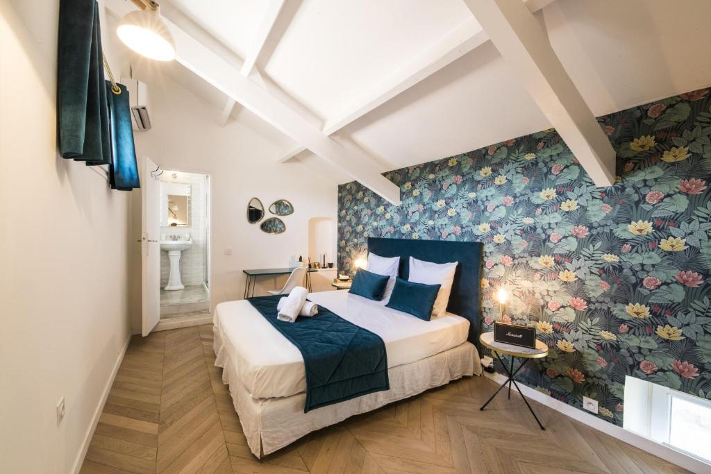 A bed or beds in a room at Le Vernet