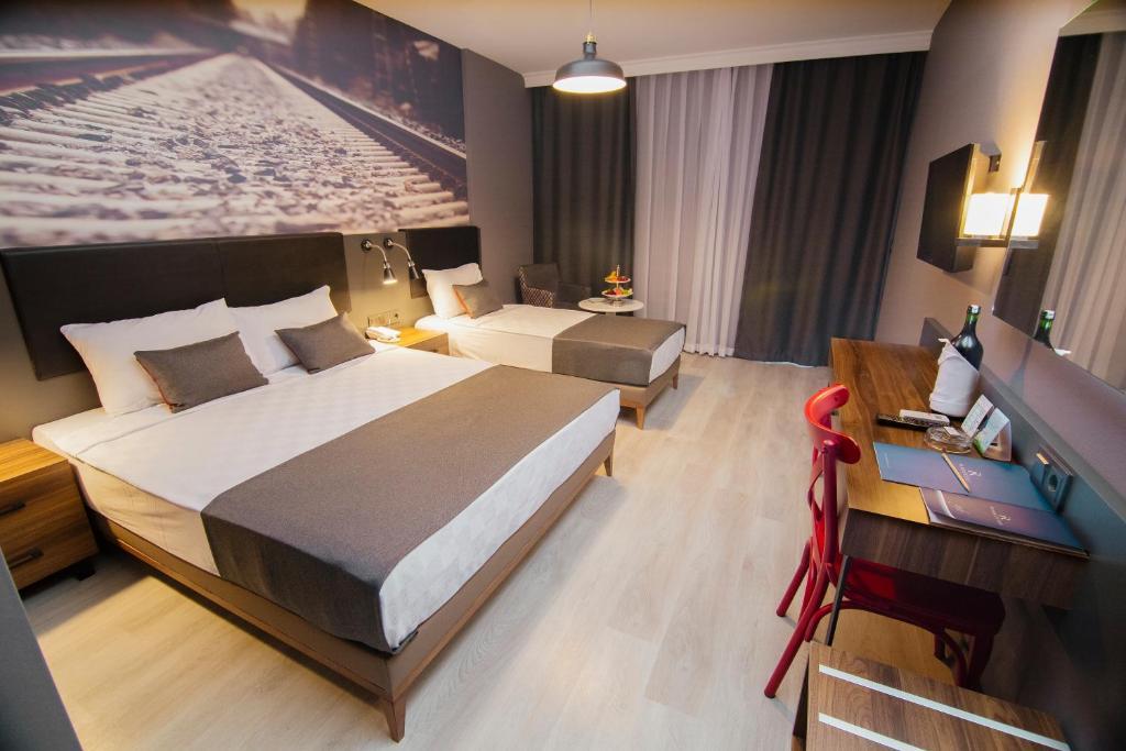 Кровать или кровати в номере Ramira City Hotel - Adult Only (16+)