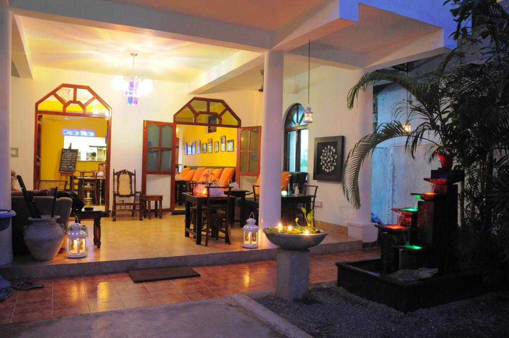 A restaurant or other place to eat at Prime Time Hotel Sri Lanka