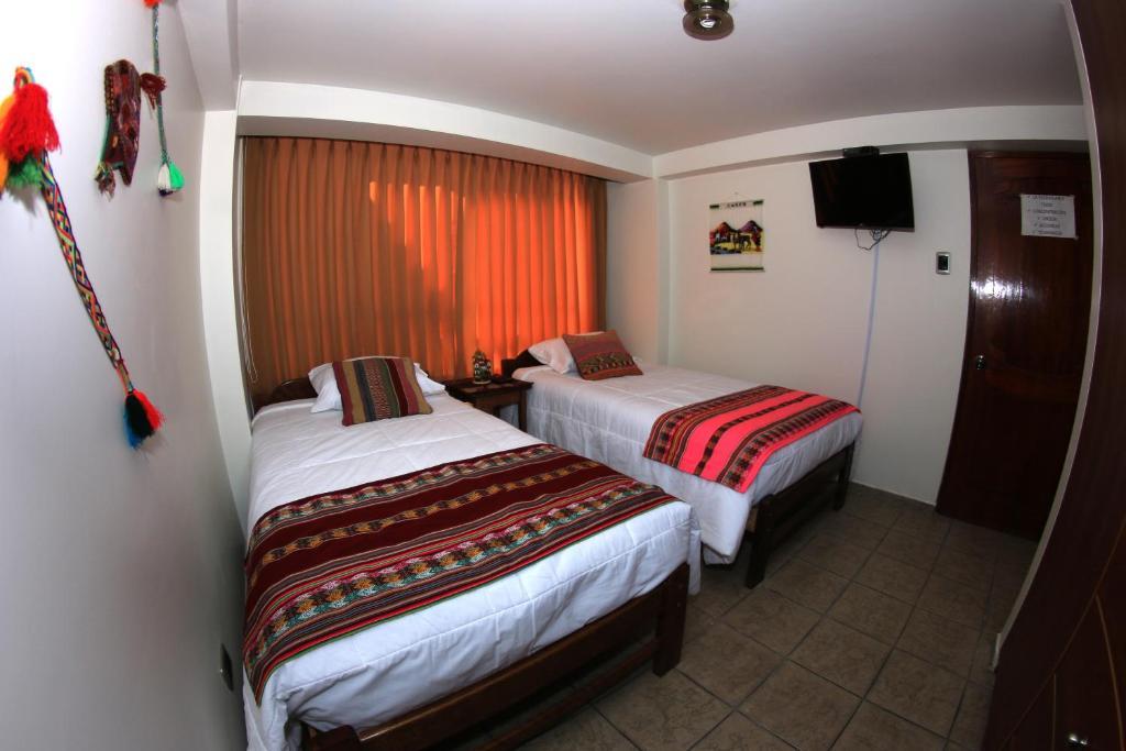 Cama o camas de una habitación en Happy House Inn