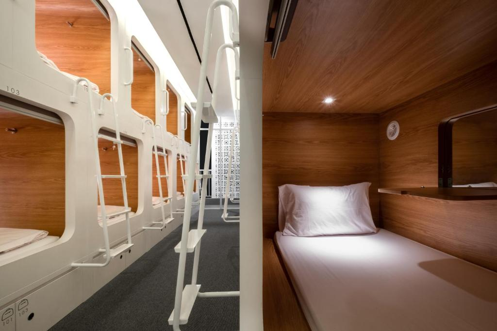 A bunk bed or bunk beds in a room at KINI Capsule