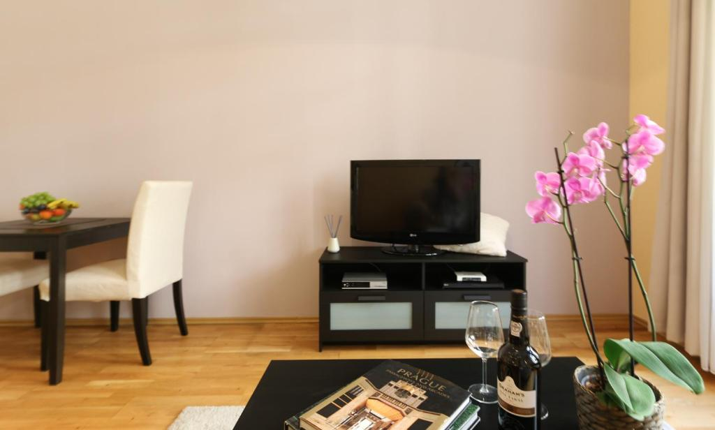 A television and/or entertainment center at Vinohrady Moravska Apartments