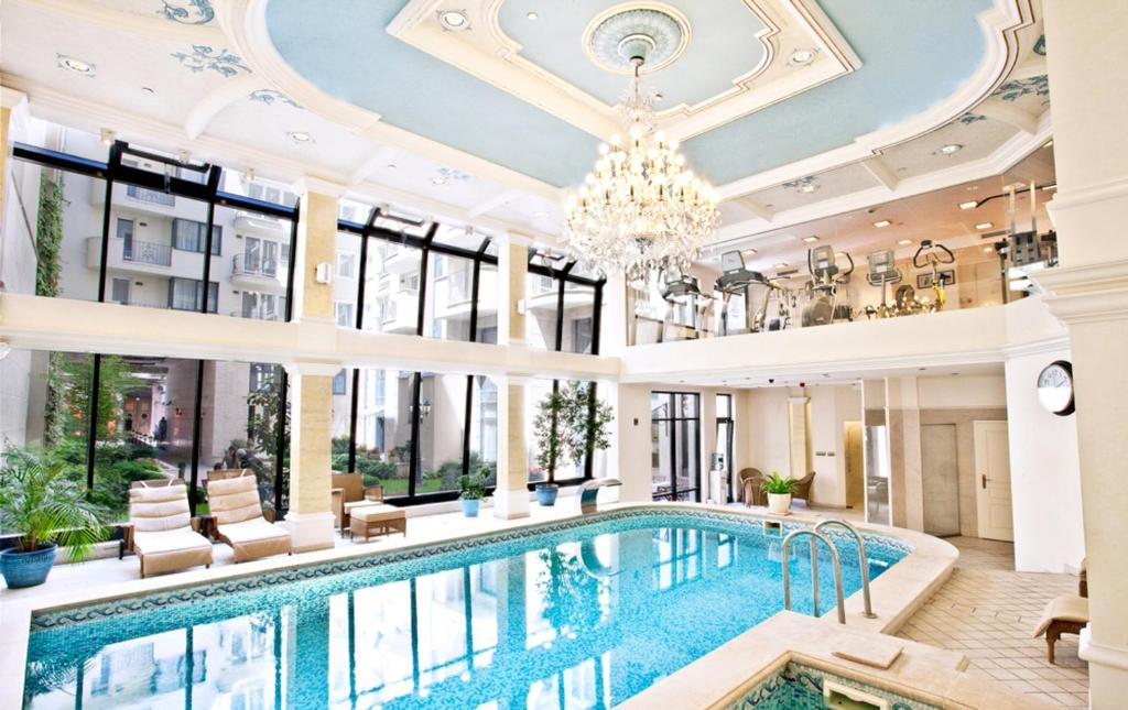 The swimming pool at or near Queen's Court Hotel & Residence