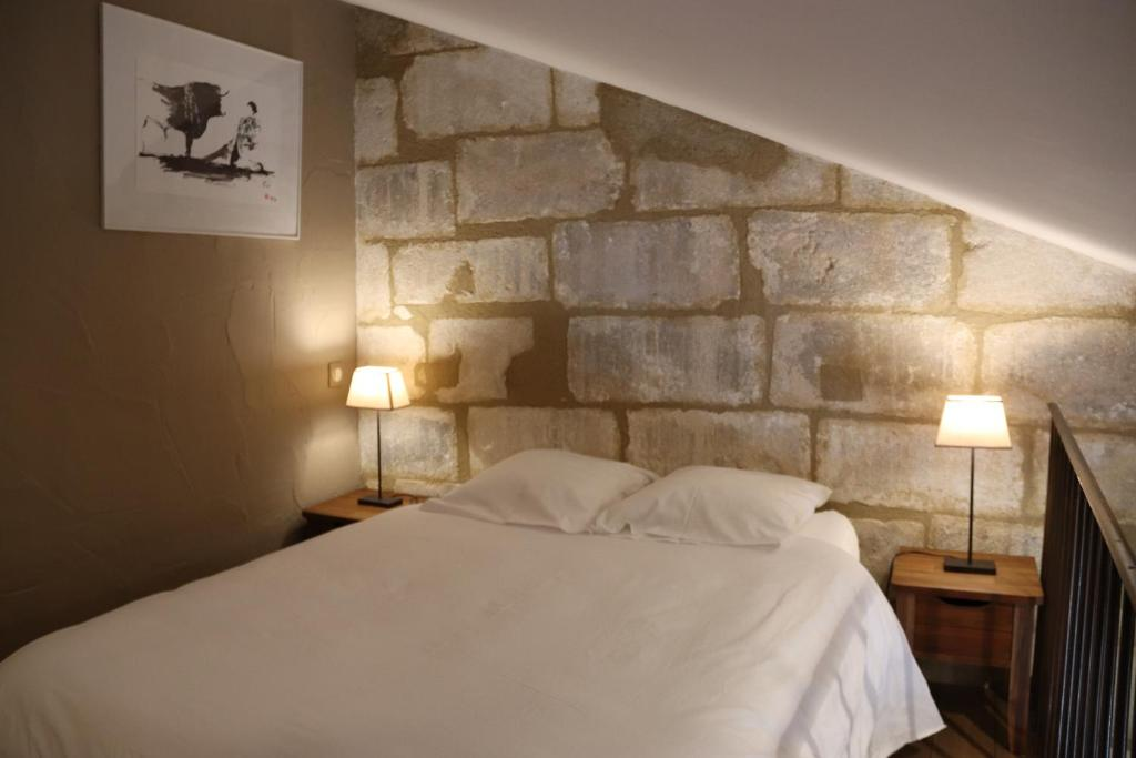 A bed or beds in a room at Charme En Provence
