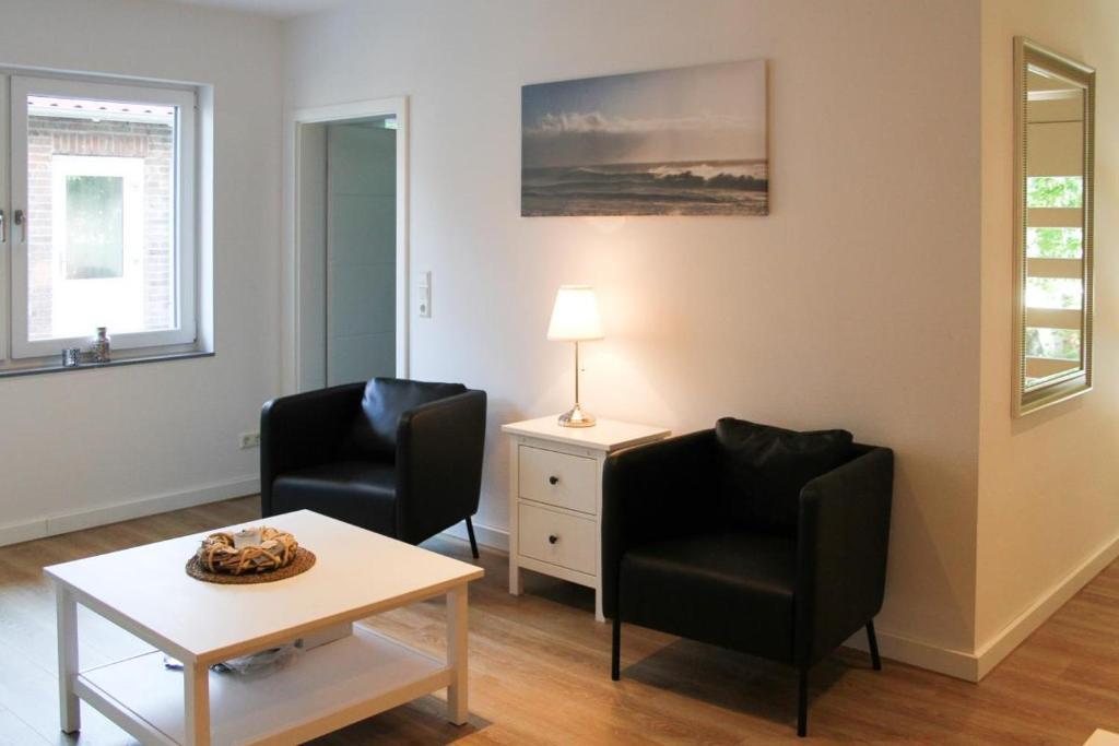 Ein Sitzbereich in der Unterkunft Haus an den Salzwiesen - Wohnung Heringsmöwe