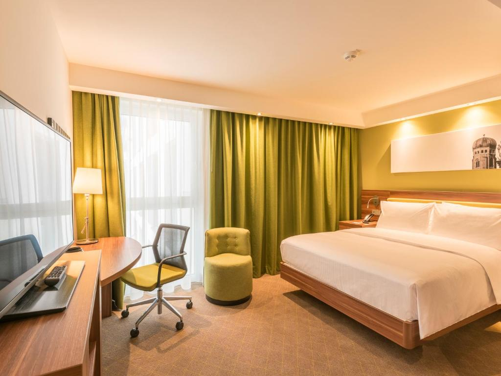 A bed or beds in a room at Hampton By Hilton Munich City West