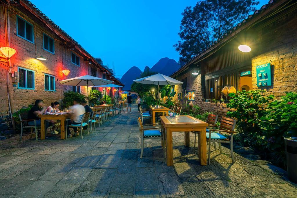 Restaurant ou autre lieu de restauration dans l'établissement The Giggling Tree